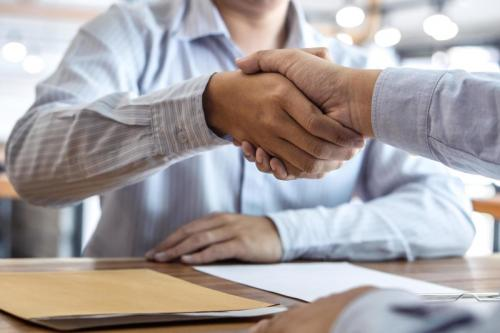handshake-of-two-business-partners-free-photo.jpg