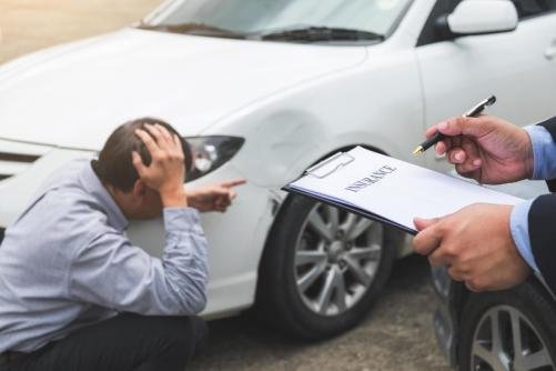 insurance-agent-working-on-report-from-car-accident-free-photo.jpg